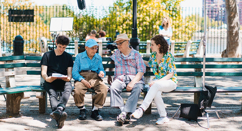 a group of people sit on a bench from the film My Annie Hall