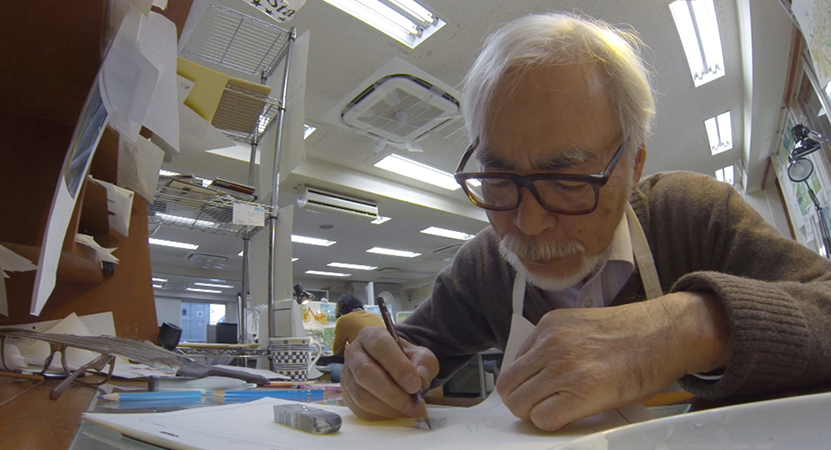 Hayao Miyazaki works at a drawing table from the film Never-Ending Man: Hayao Miyazaki