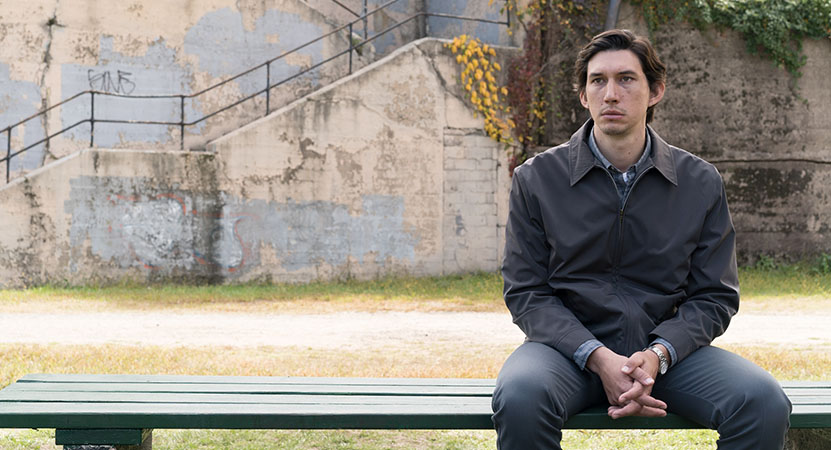 a man sits on a bench from the film Paterson
