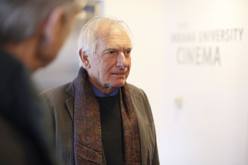 Peter Weir greeting guests in the lobby of IU Cinema.