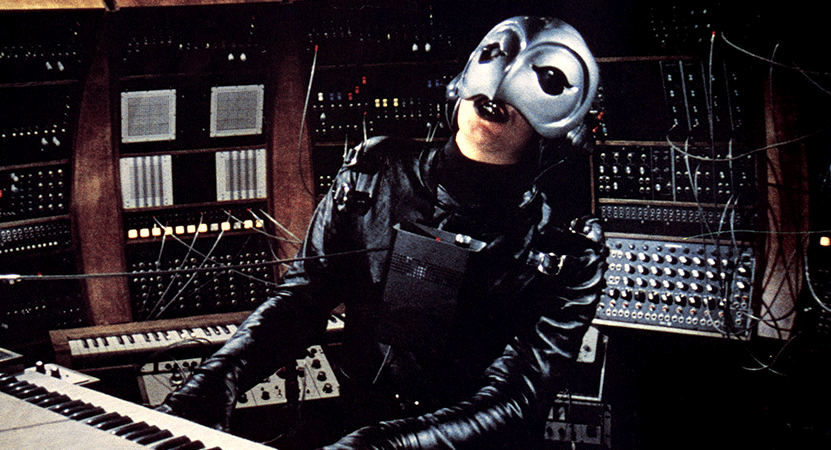 a masked person plays music from the film Phantom of the Paradise