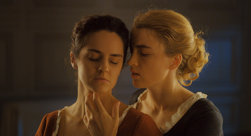 two women embrace from the film Portrait of a Lady on Fire