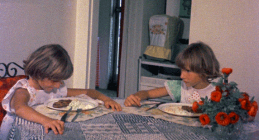 two children eat at a table from the film Poto and Cabengo