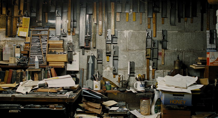 still image of a letter press shop from the film Pressing On: The Letterpress Film.