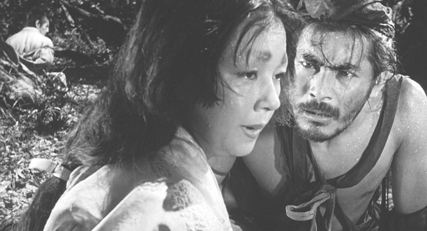 a man looks at a women intensely from the film  Rashōmon