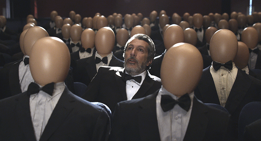 a man in a suit sits in a crowd of manikins from the film Réalité (Reality).