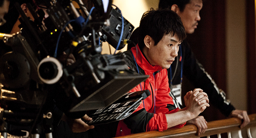director Ryoo Seung-wan working on set.