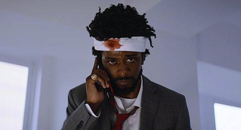Man on the phone with a bandage on his head form the film Sorry To Bother You.