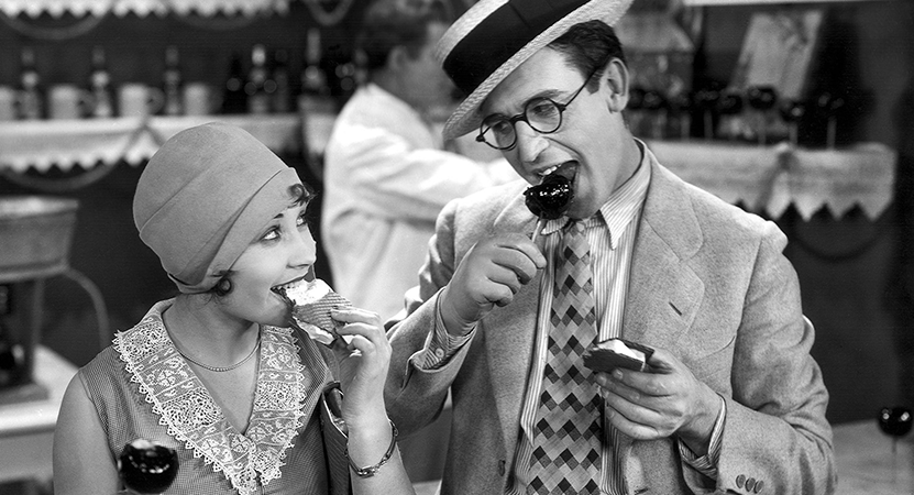 a man and a women enjoy a snack from the film Speedy