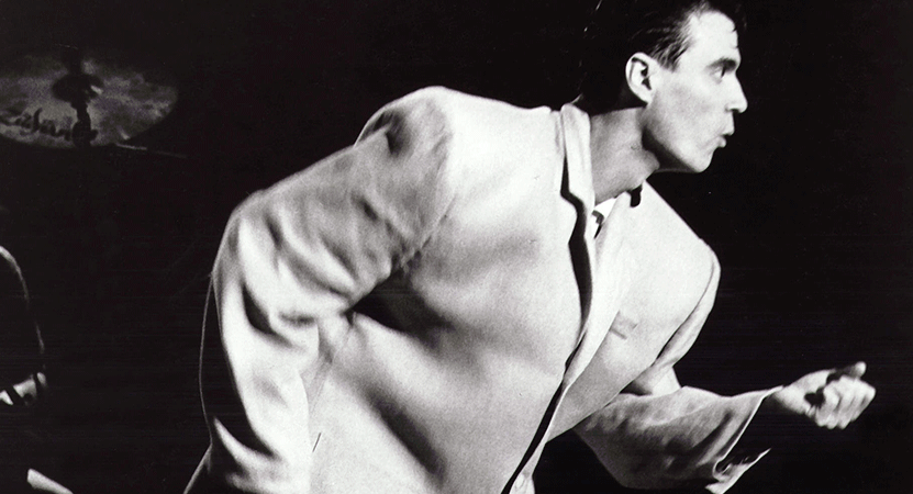 a man performs on stage from the film Stop Making Sense.