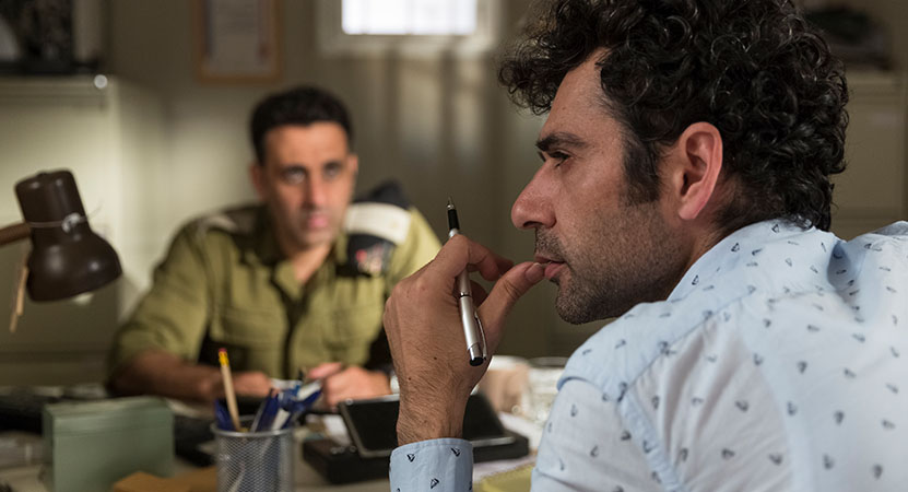 two men sit at a desk from the film Tel Aviv on Fire