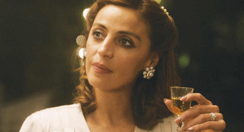 a woman holds a drink from the film Las niñas bien (The Good Girls).