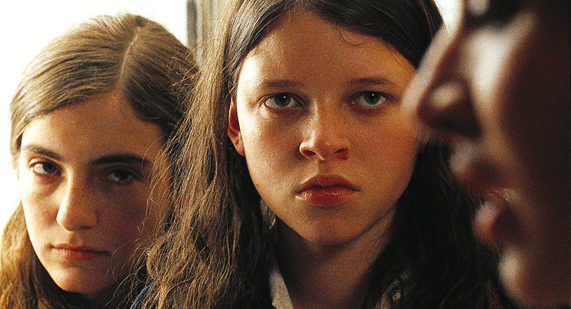 a girl looks forward from the film La niña santa (The Holy Girl).