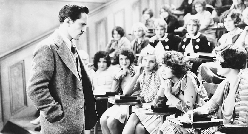 a man stands infont of a lecture hall full of people from the film The Wild Party