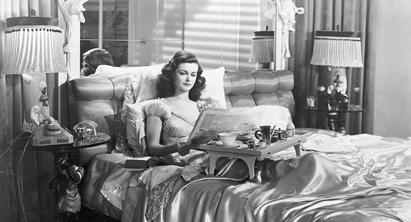 A women sits in bed from the film The Woman in the Window