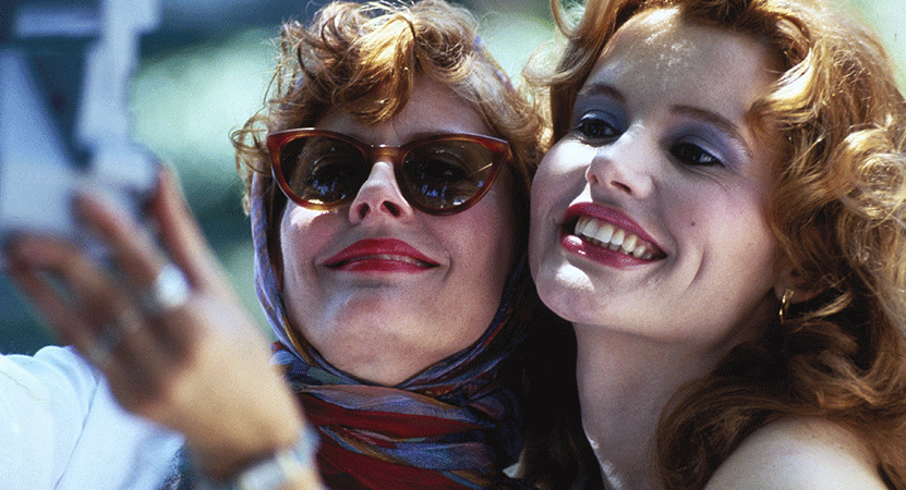two women take a photo together from the film Thelma and Louise.