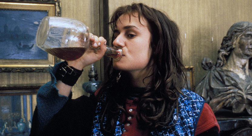 a women drinks from a bottle from the film Vagabond