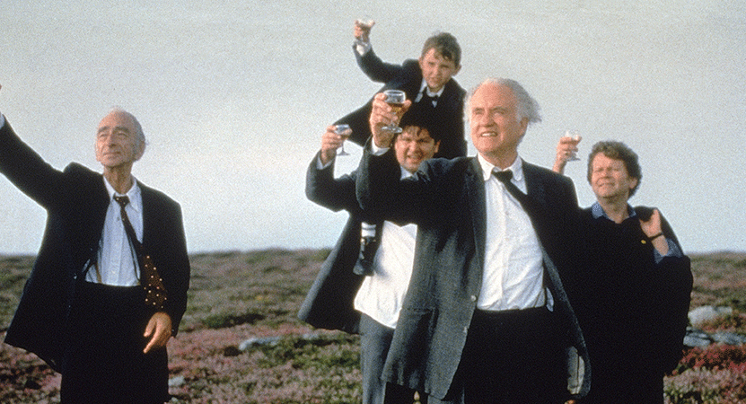 a group of people raise a glass from the filmWaking Ned Devine.
