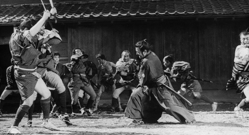 a man fights a group of soldiers from the film Yojimbo